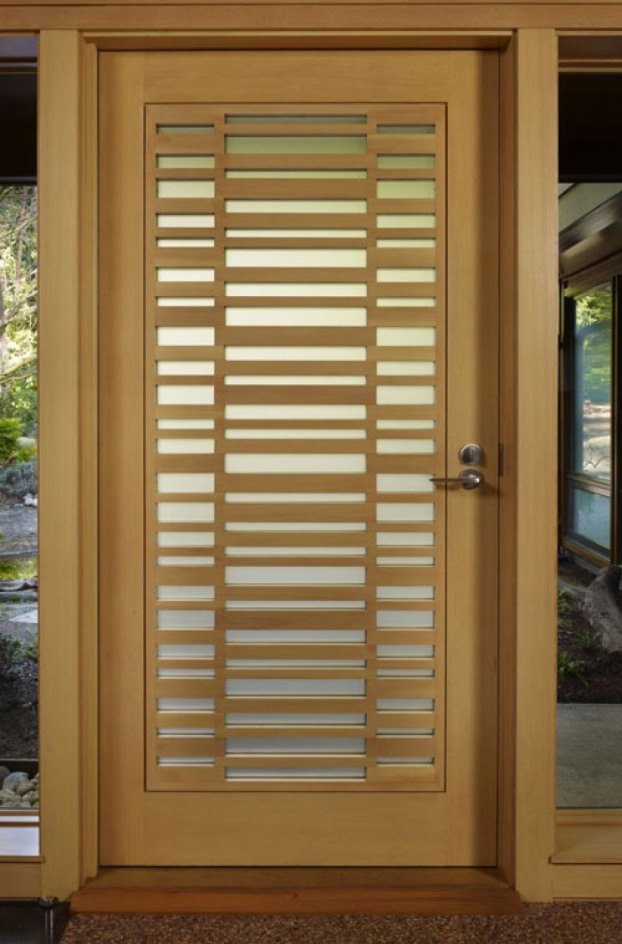 Wooden safety door designs for homes for Door pattern design